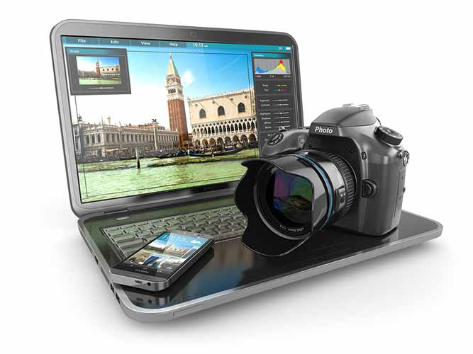 Laptop and camera for corporate photography and video production services.